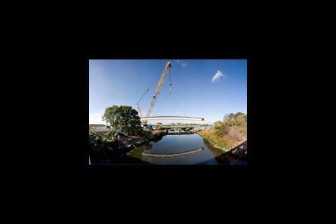 First bridge lifted into place on Olympic site